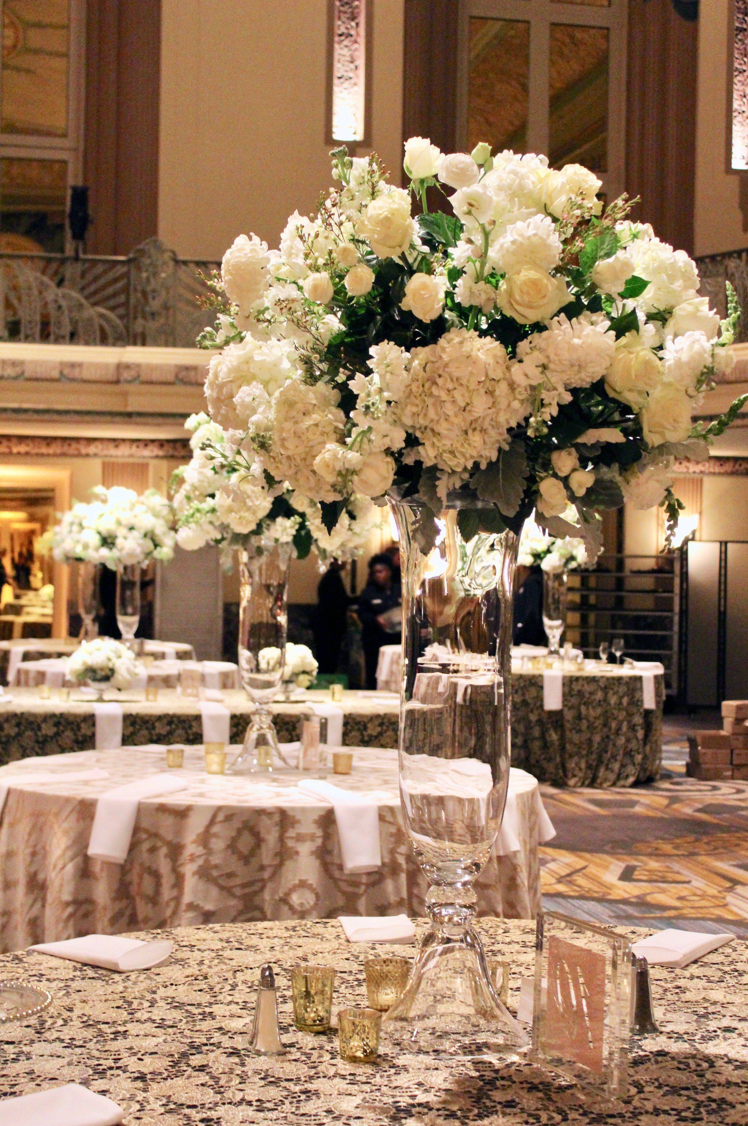 Hall of Mirrors wedding with green, white, and blush florals