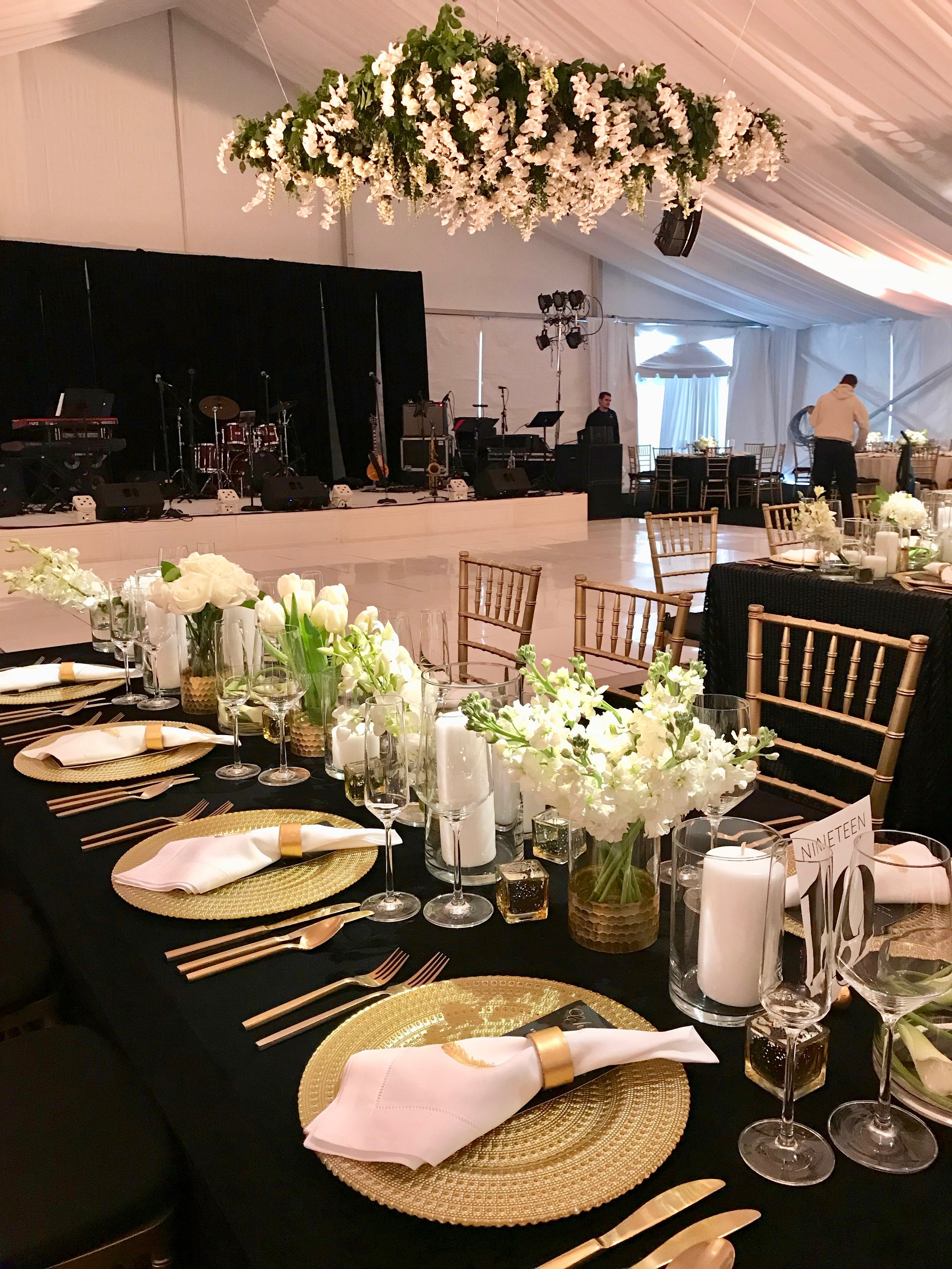 Gold chargers and flatware with black and gold dinner menus