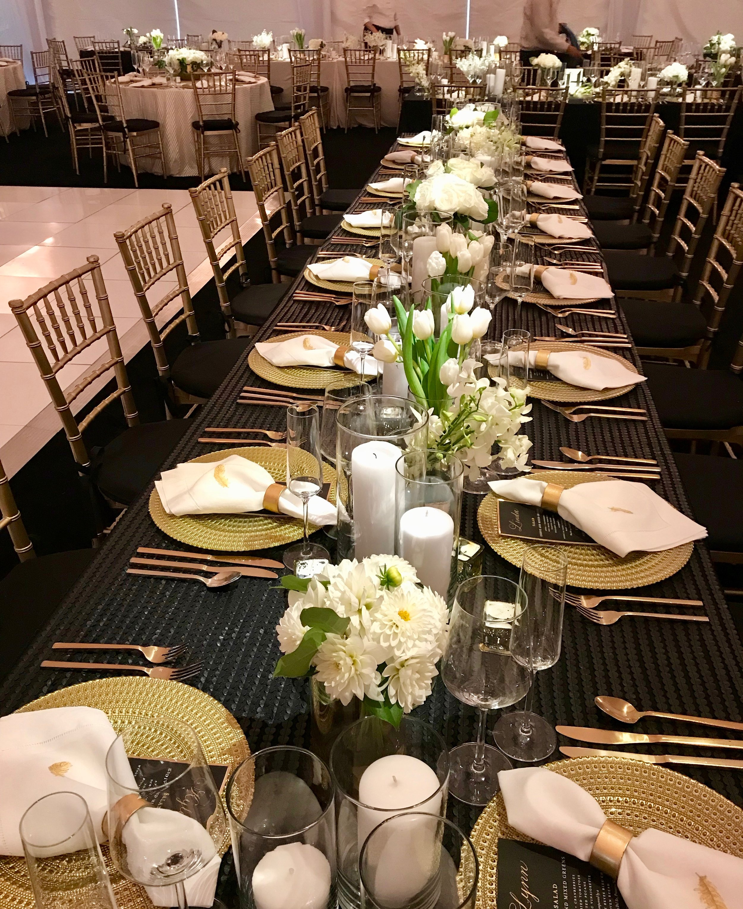 White tulips and dahlias for family style table