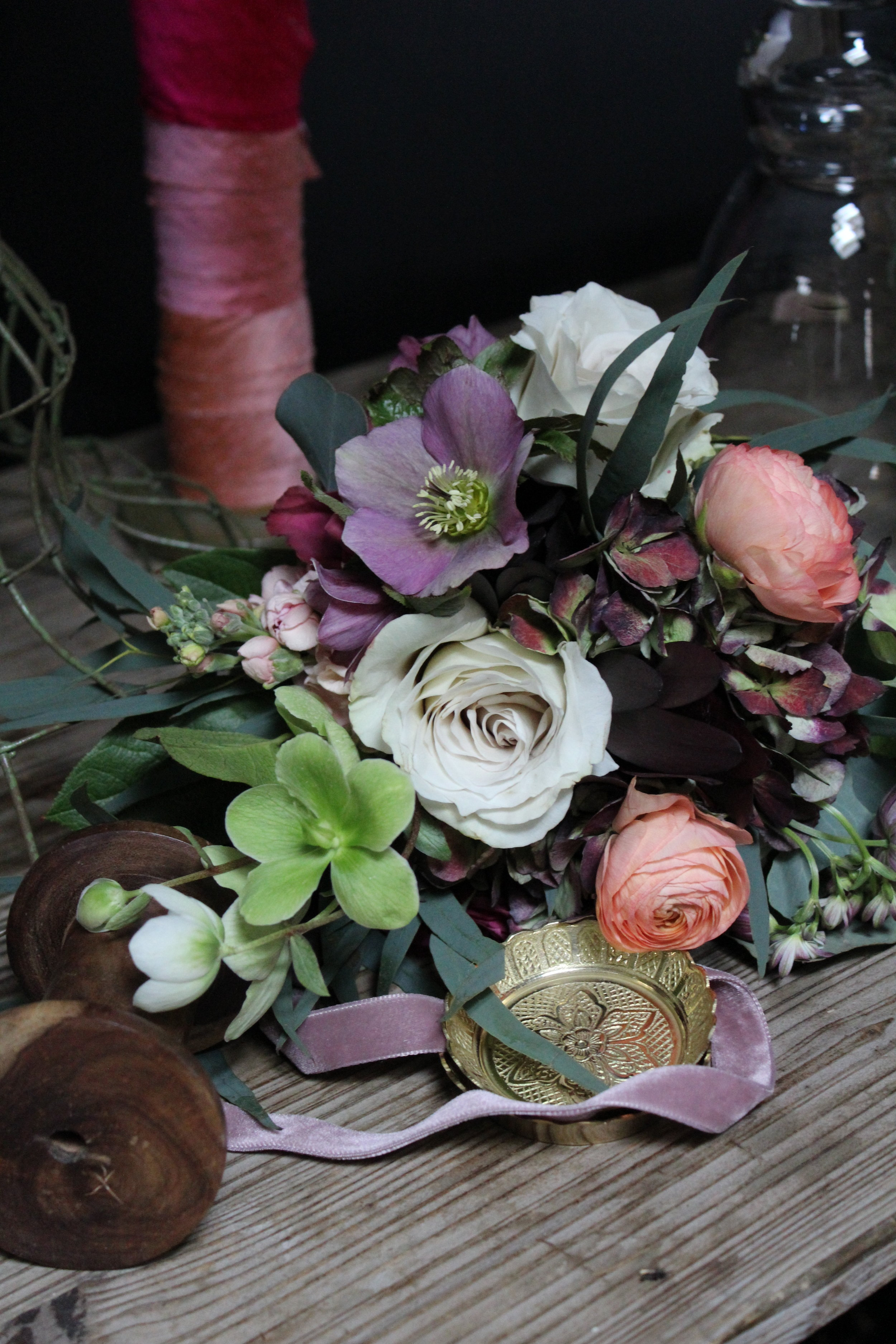 Arrangement with peach, blush, and white for spring wedding in Cincinnati by Yellow Canary. www.yellowcanaryonline.com