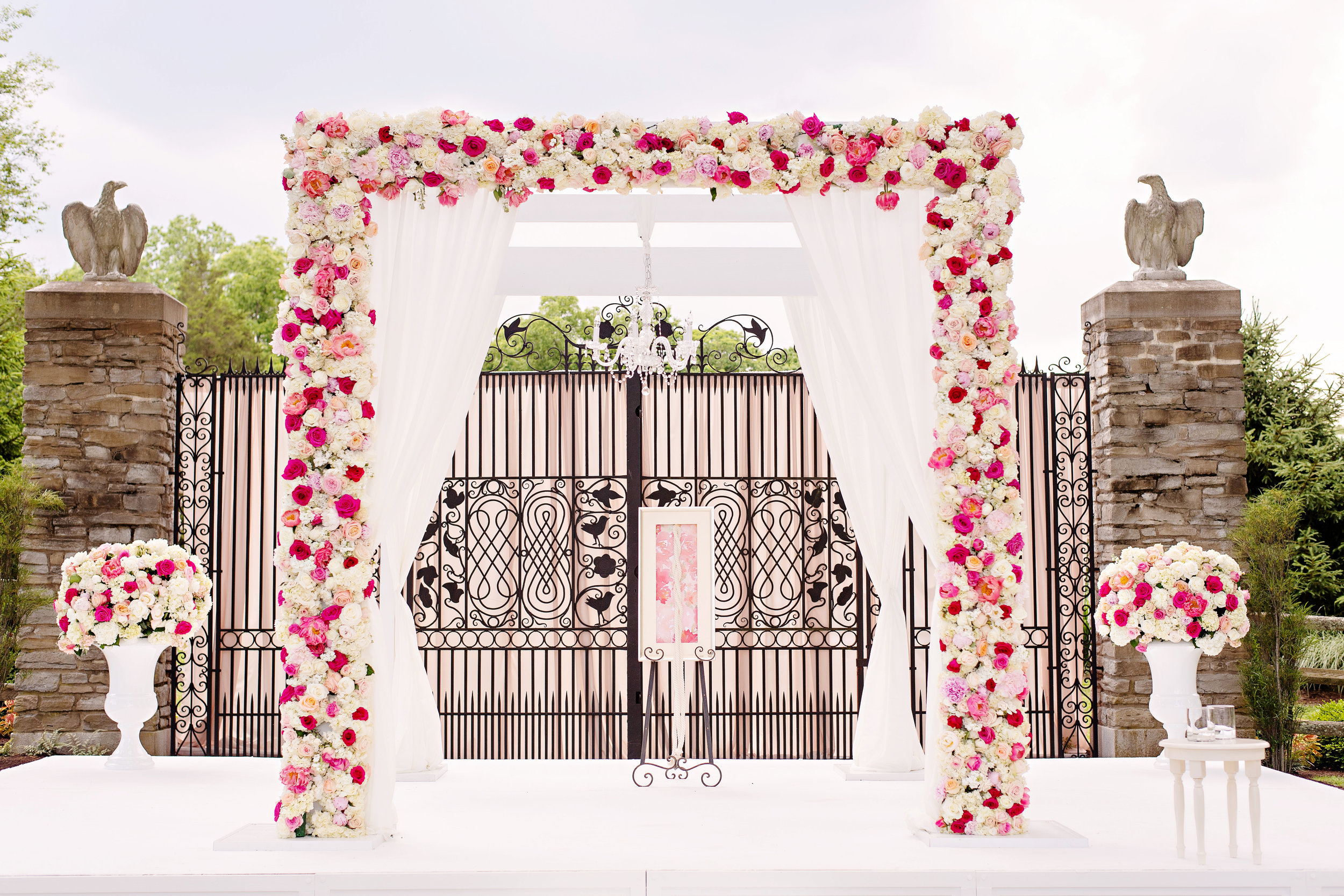 Magenta and blush floral wedding ceremony arch by Yellow Canary