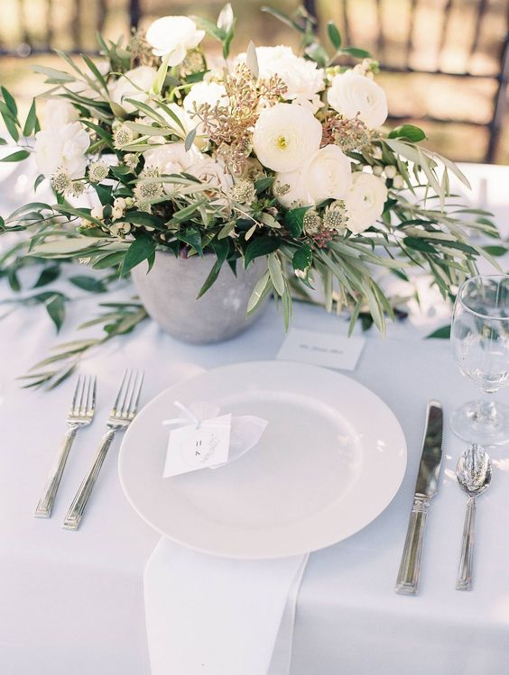 Olive and white florals with ceramic vessels