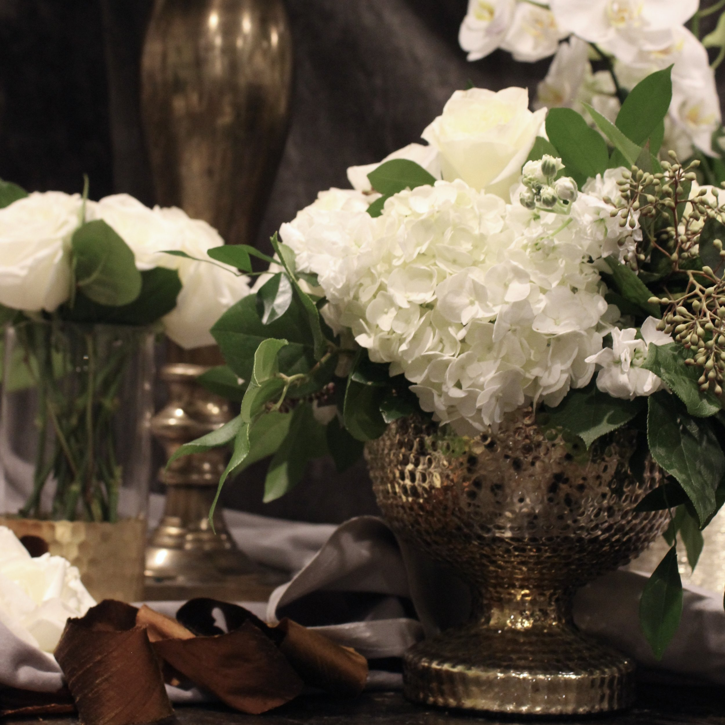 Green and white florals with vintage gold vessels