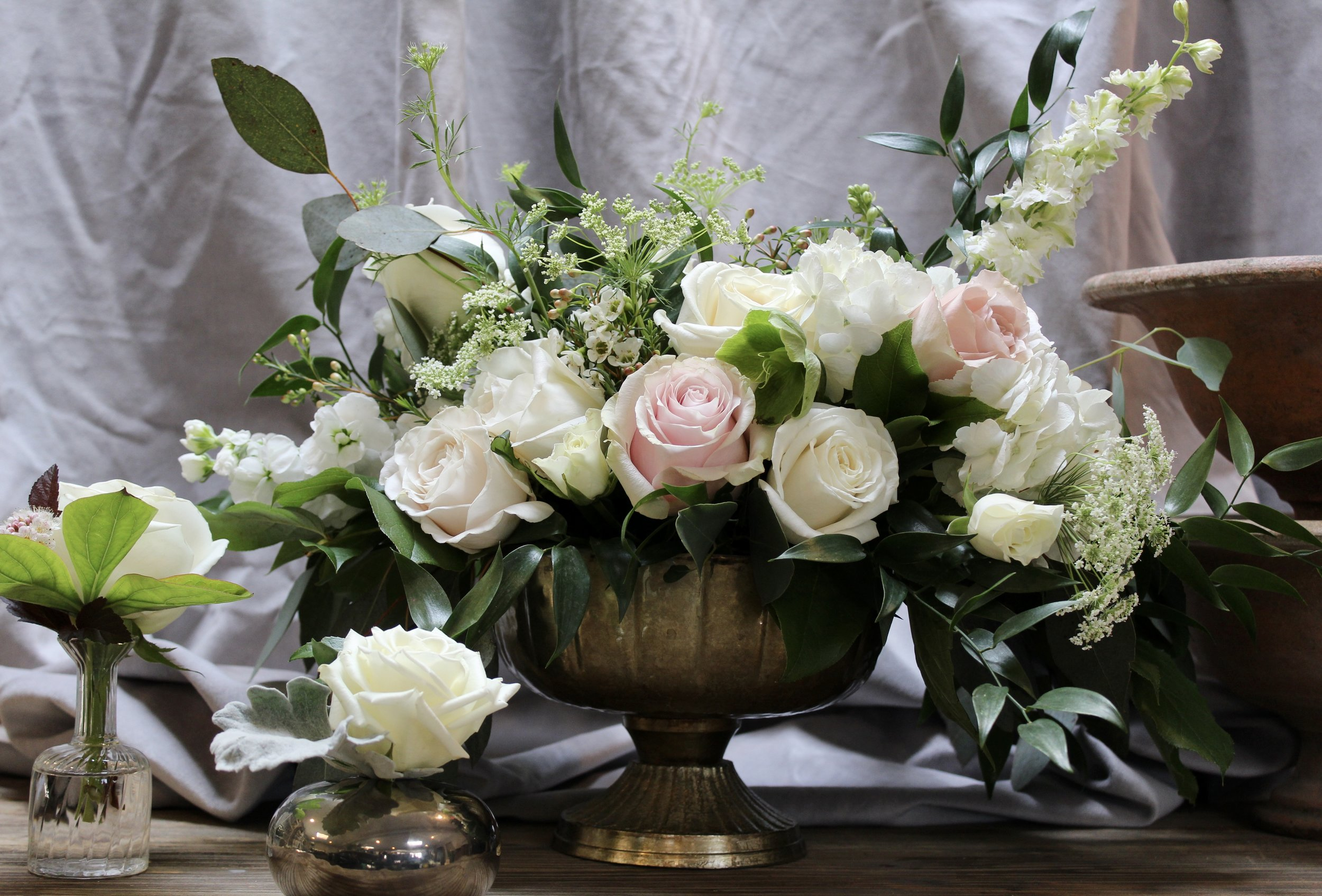 Yellow Canary Floral & Design Studio wedding floral arrangement with white and blush roses and wildflowers.