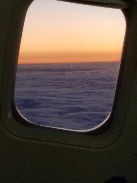 - As we took off just before 6 PM CDT, I took one last picture from Texas from the plane: a sunset just as the plane climbed above the cloud layer. We were headed home.