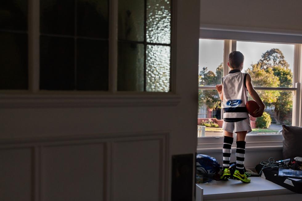 LaurenMcAdamPhotographyGeelongSEPDottoDot2017 boy with afl football