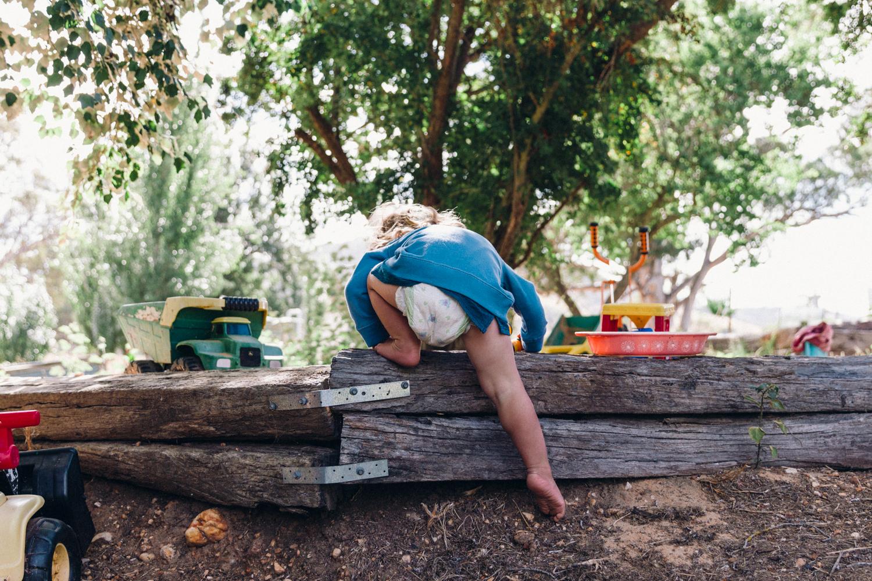 Lauren McAdam photography Geelong Newton Torquay family photographer ballakaye boy nappy climbing into sandpit