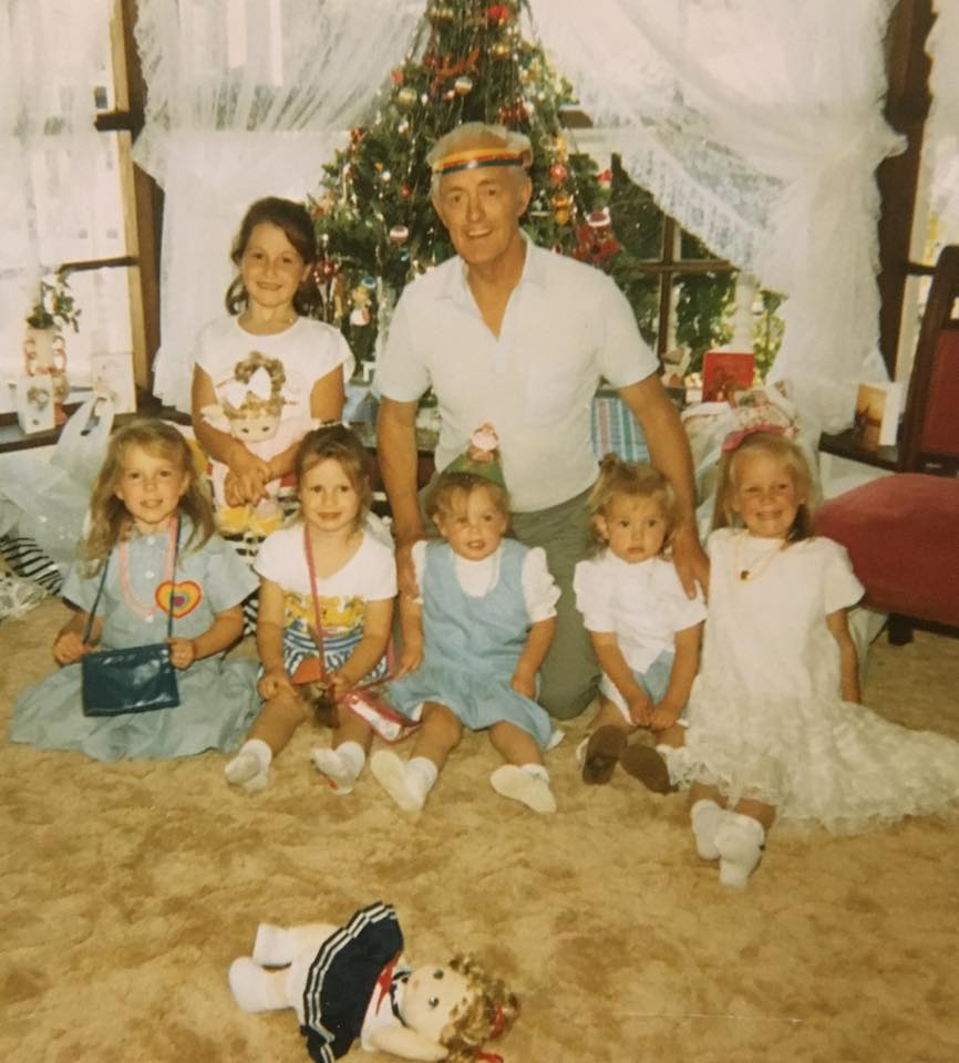 Christmas day in front of the bay window.  Poppa wearing his rainbow headband.  That's me on the far right along with my sister and cousins