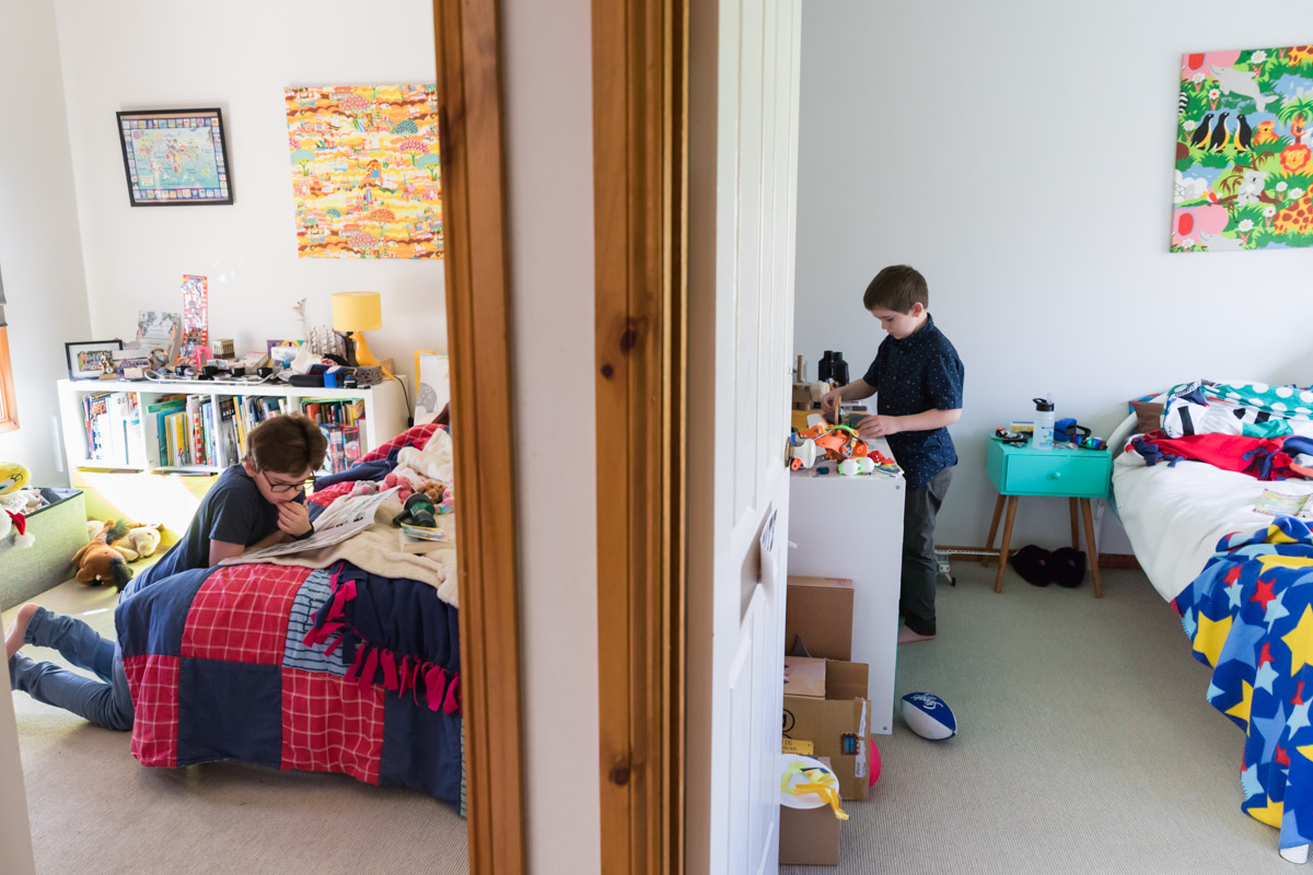 Split scene looking into two boys bedrooms in a geelong home photography session