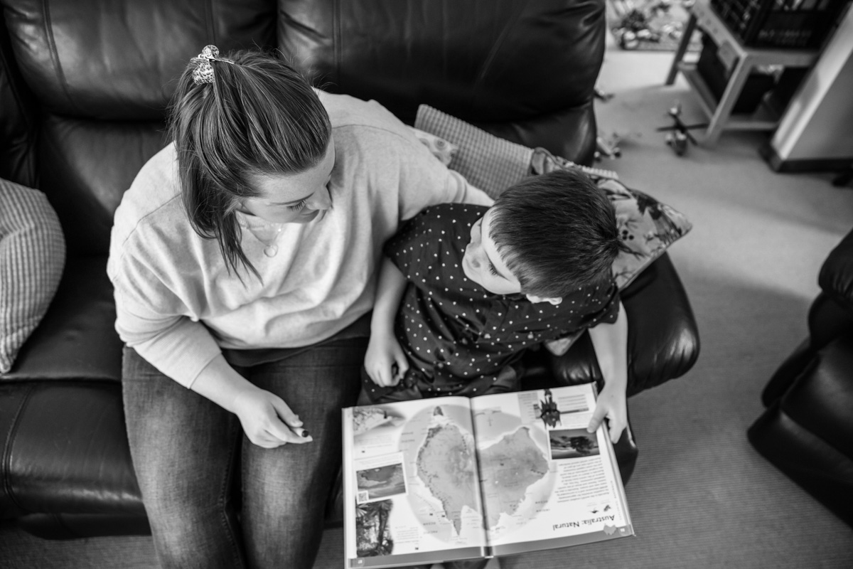 Mother and son share a moment while reading a book together