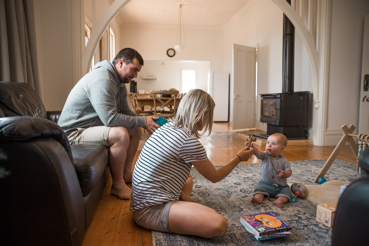 Baby sitting on floor with parents - Newtown, Geelong, Belmont newborn photographer