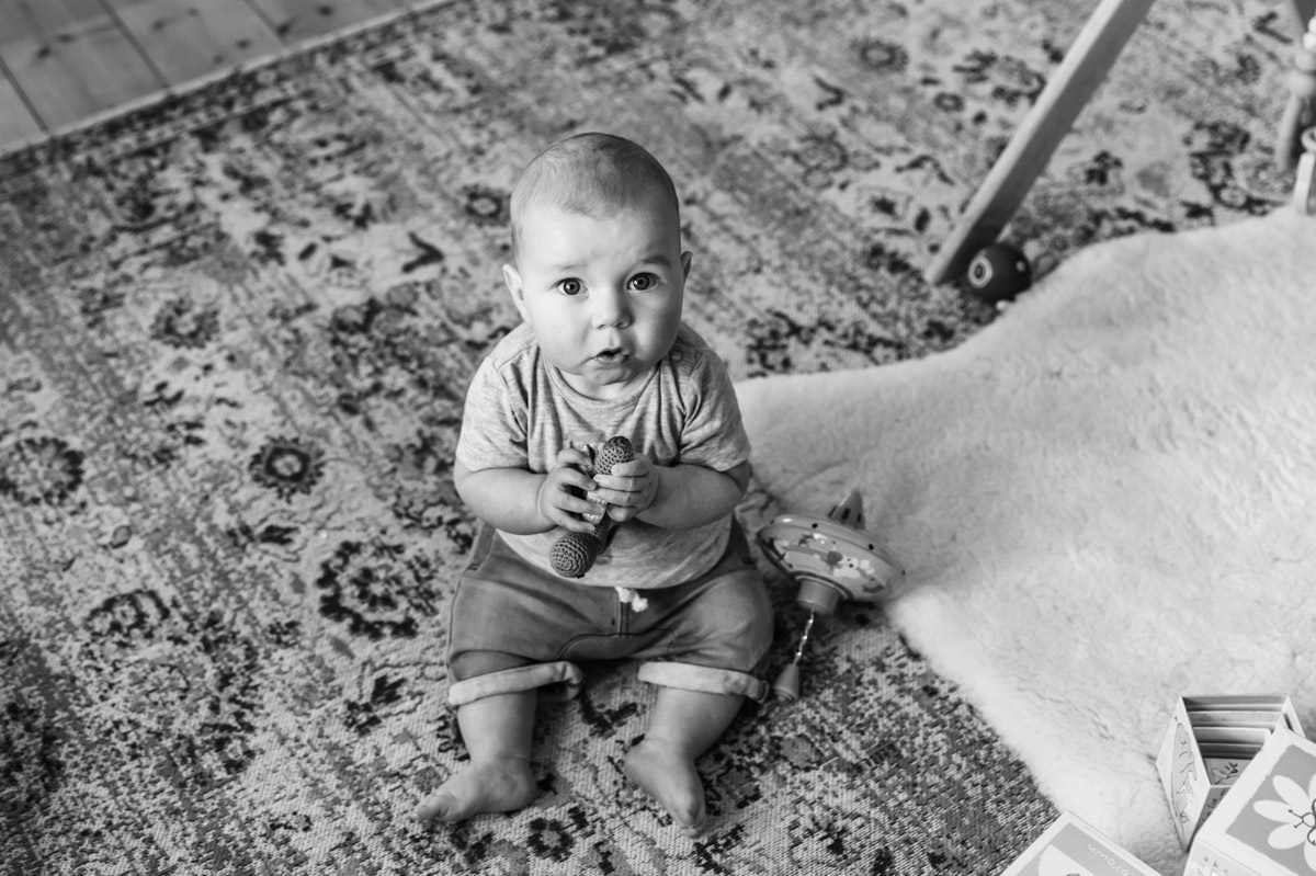 Baby sitting on the floor with toys in home session Geelong Photographer