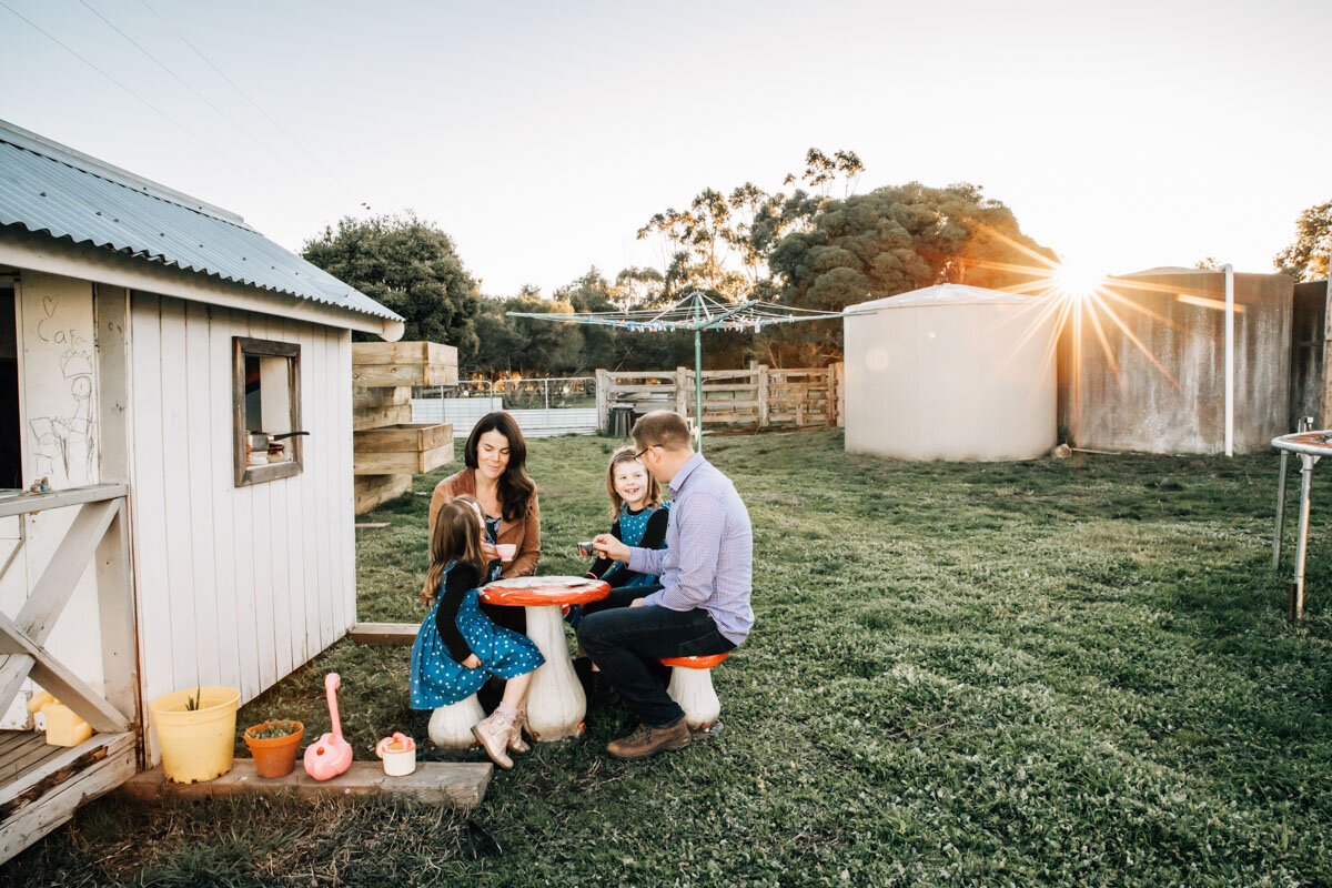 Family sitting on a toadstool table in the afternoon sun Lauren McAdam Photography Geelong torquay newtown armstrong creek moriac family photographer-24.jpg
