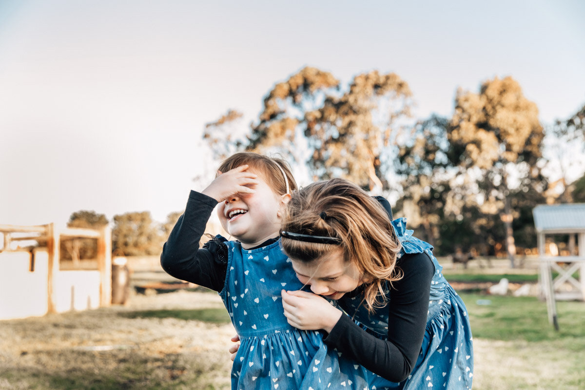 Two sisters laughing Lauren McAdam Photography Geelong torquay newtown armstrong creek moriac family photographer-21.jpg