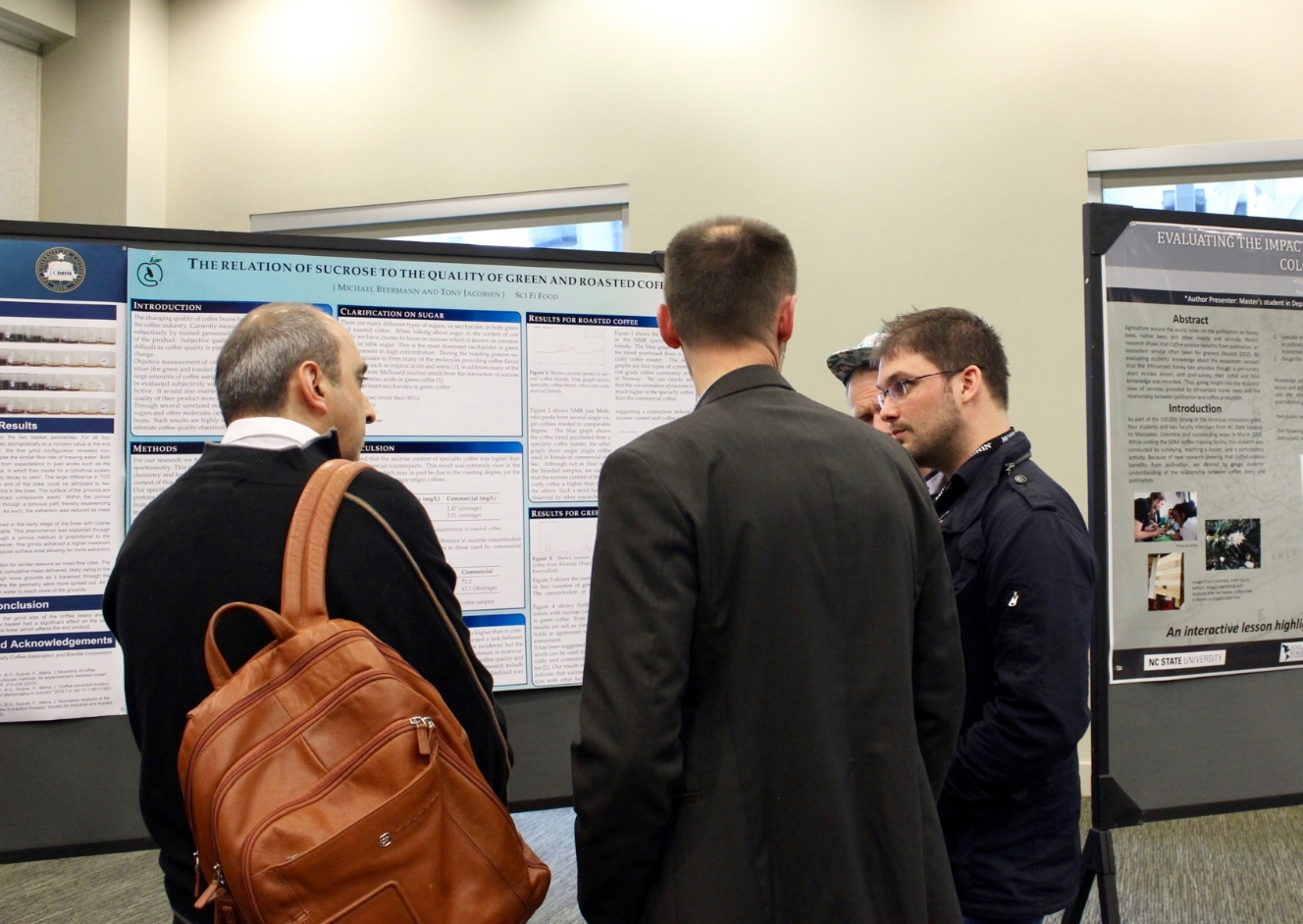 Tony and Michael presenting our research to Ludovic Maillard and Chahan Yeretzian from SCA. Image taken by the Daily Coffee News.