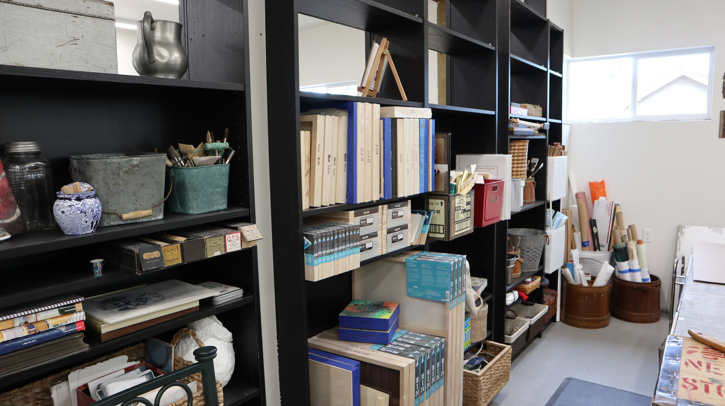 On the back side of the wall, the bookcases allow tons of room for supplies!