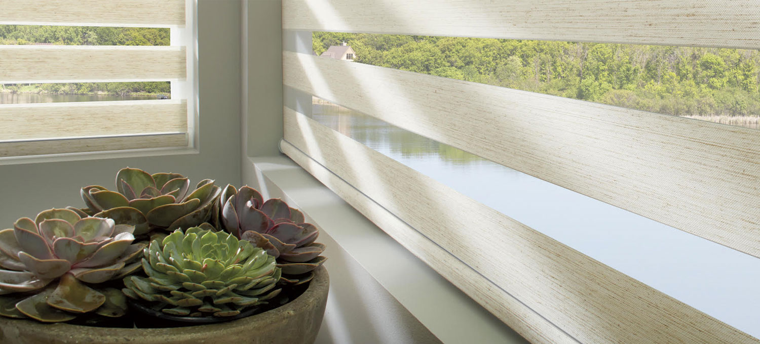 Why choose our banded shades for your home? - Designer Banded Shades combine alternating sheer and solid bands in a single shade. Shift the solid bands to overlap, and you ensure privacy. Align the solid bands, and you get natural, diffused light. With each adjustment, you create your precise level of sun and privacy.