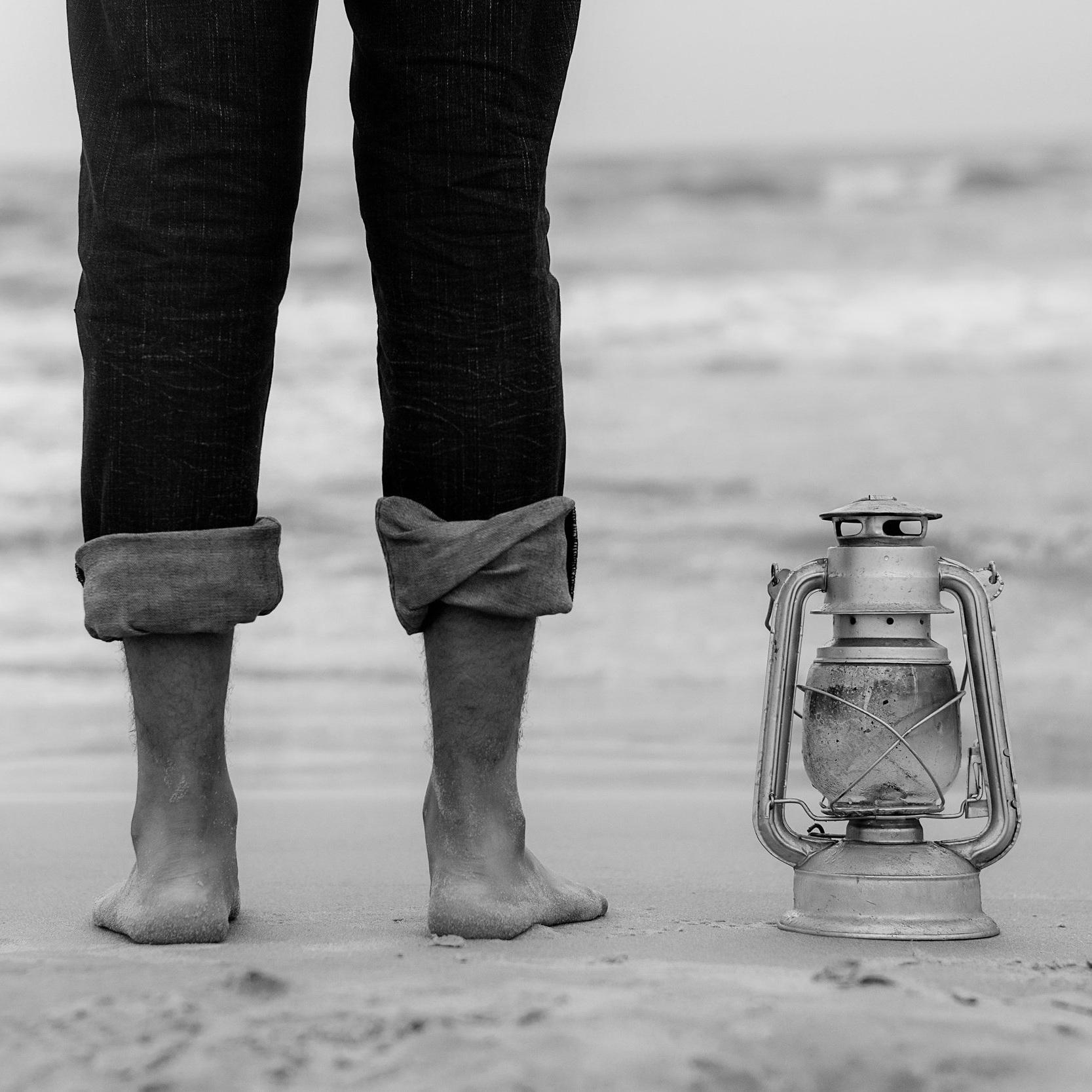Canva+-+Person+Standing+on+Shoreline+Beside+Gray+Tubular+Lantern+%281%29.jpg