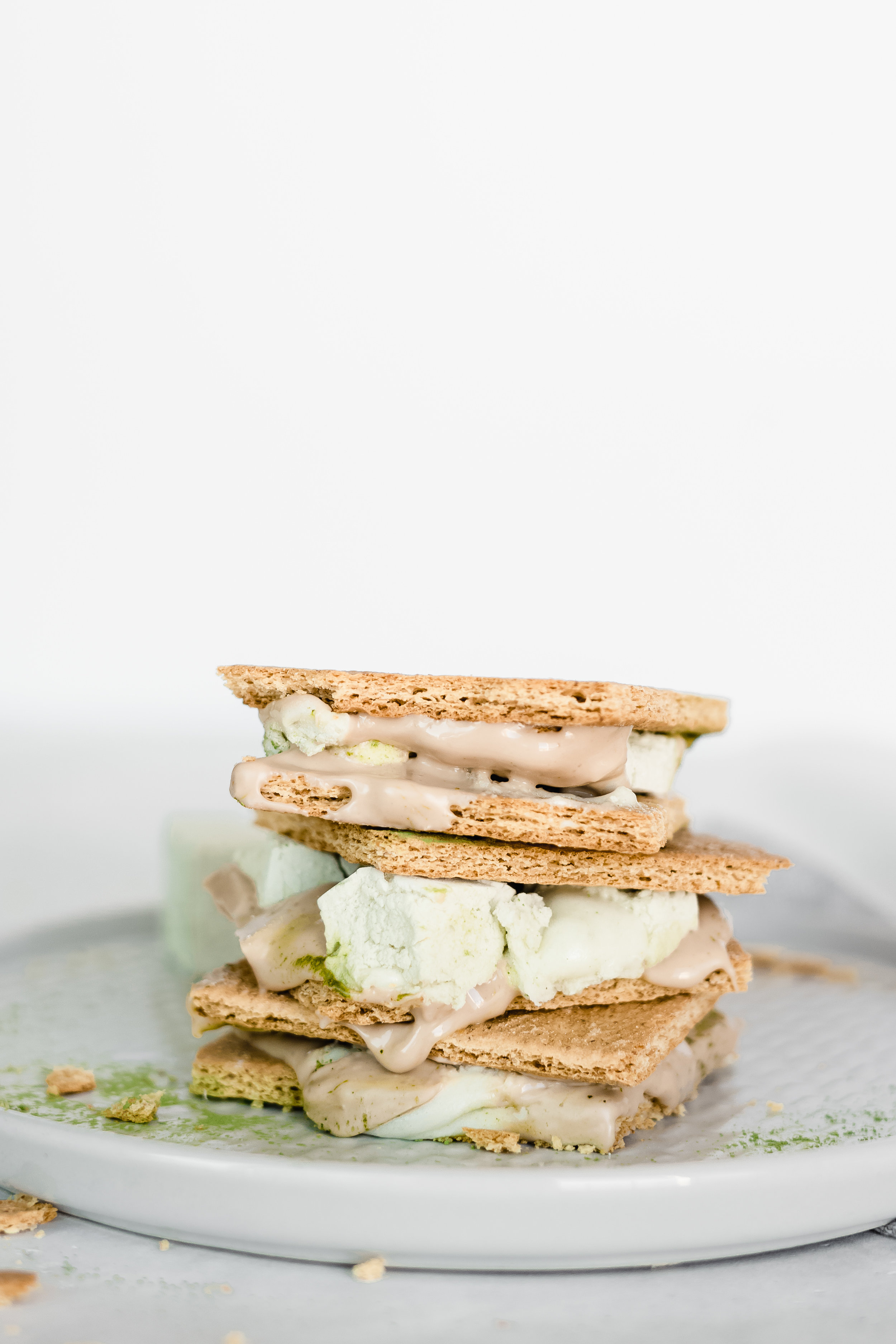 Matcha S'mores - Break a graham cracker in half and lay the two halves out on a plate.Add a few squares of blonde or white chocolate to the top of one half.Next, have a matcha marshmallow heated up, in your preferred method, and add on top of the chocolate. (You can warm the marshmellow over a fire, or stick the whole s'more in the oven or microwave.)Top off with other half of graham cracker.Smoosh together so everything mixes and melts out the sides. Then enjoy a classic s'more!