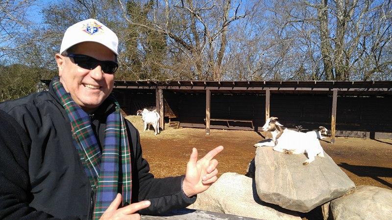 23772376_1604377102962486_1829291772_n Joel pointing at Goat.jpg