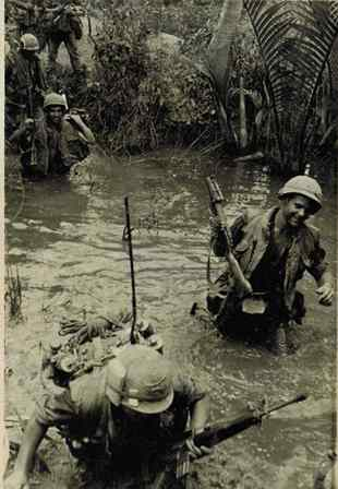 Caption Alpha Company, 3rd Bn., 7th Infantry, Carley 199th Light Infantry Brigade. Infantry moving through the Mekong Delta, Spring, 1969..jpg
