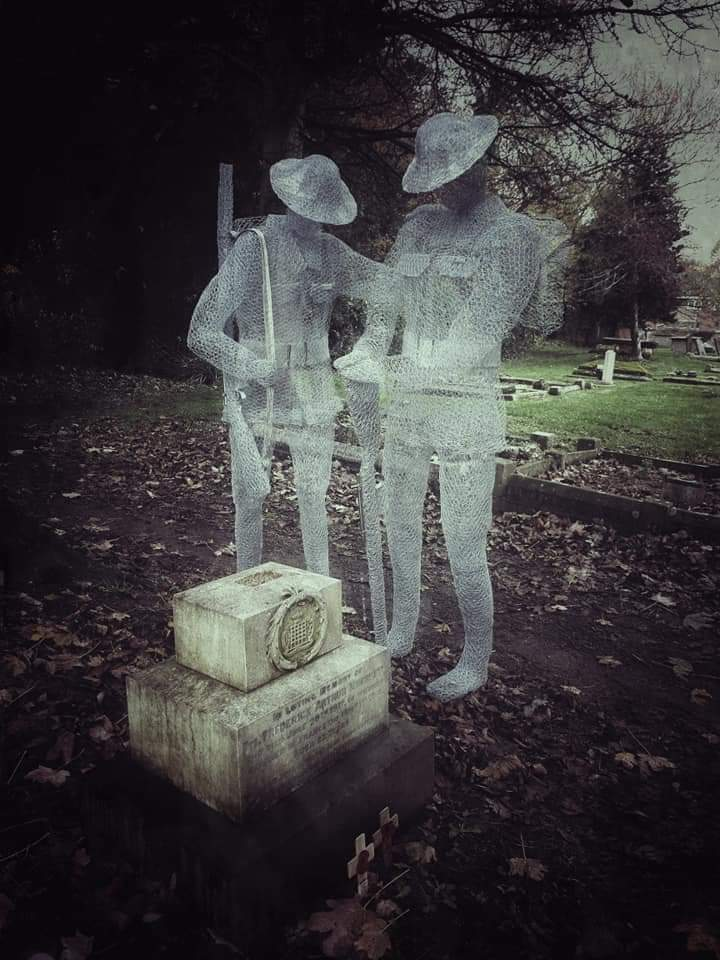 "In honor of veterans on Armistice Day. WWI. Quoted description: ""The ghosts of soldiers silently standing over their graves in the St. John's Churchyard, Slimbridge."" Gloucestershire, England. Wire sculptures by Jackie Lantell. Photo source unknown."