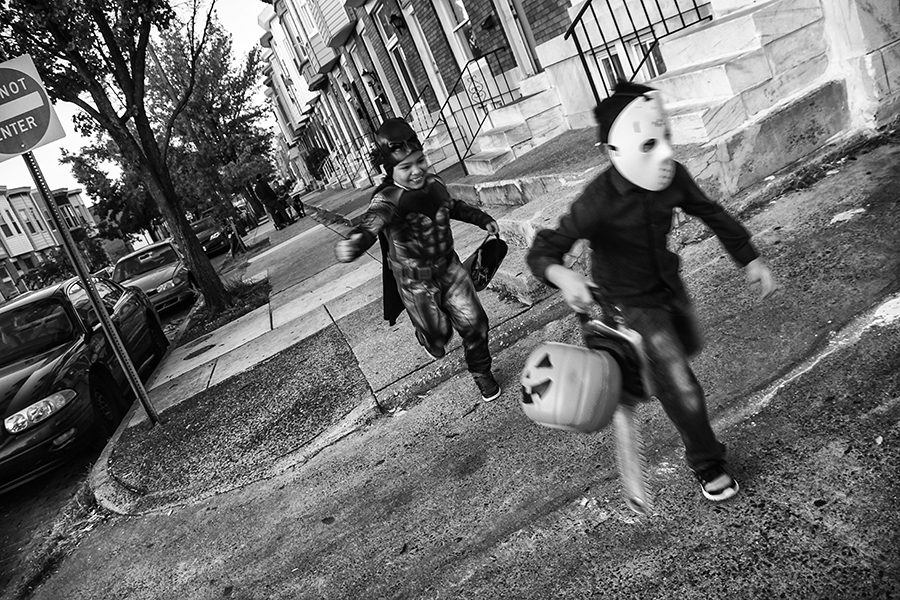 A seven year old trick-or-treating in Baltimore's Highlandtown