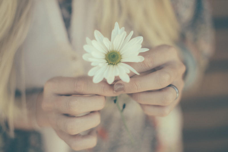 30170_woman_holding_flower.jpg