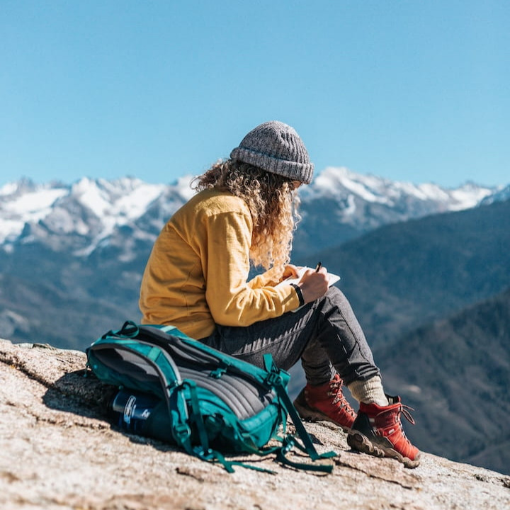 woman+with+anxiety+journaling+in+the+mountains.jpg