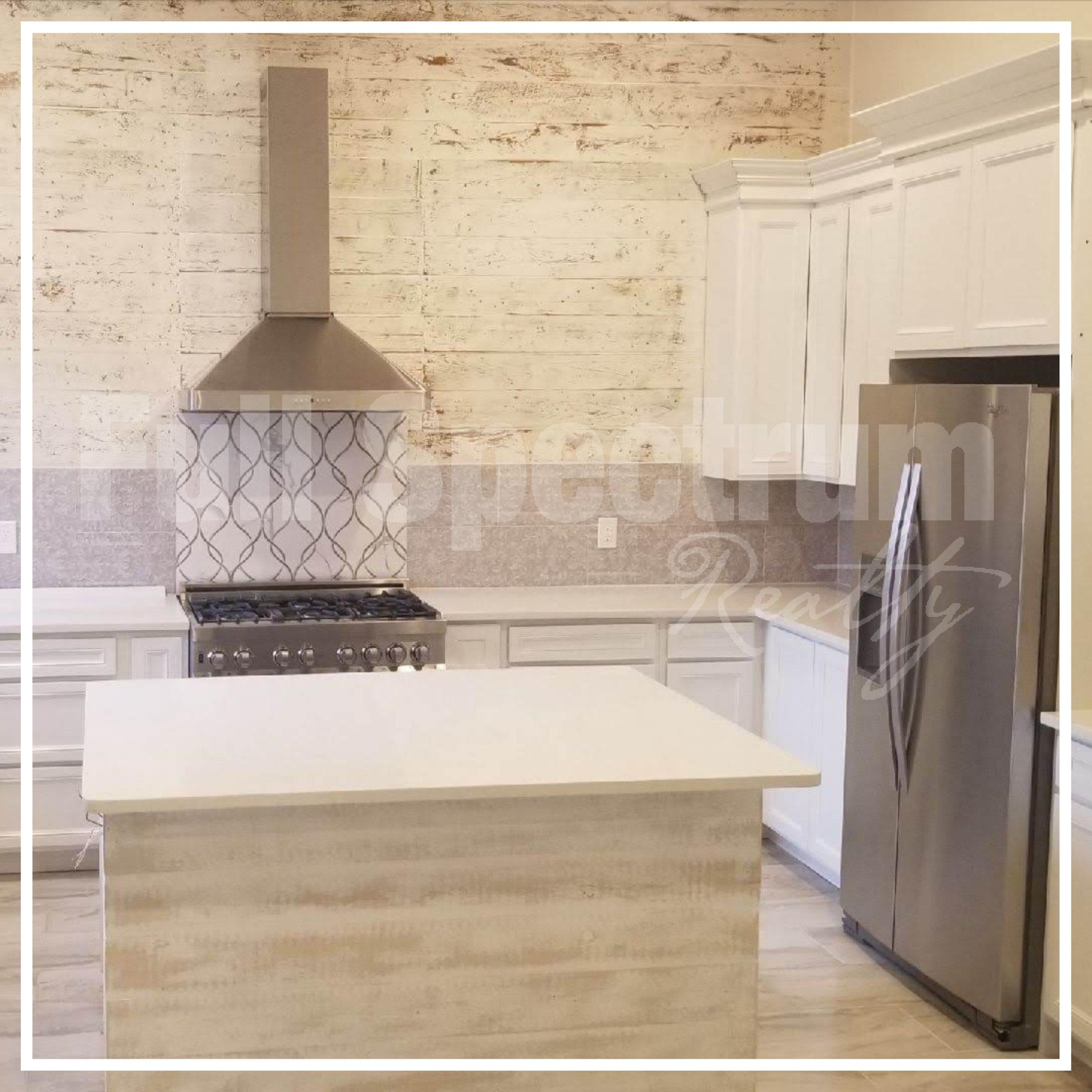 kitchen cabinet and backsplash install.jpg