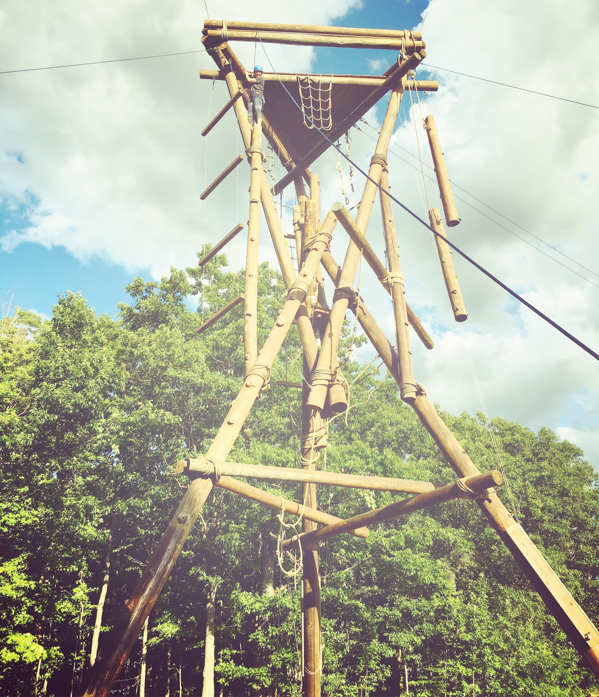 """This is me conquering another """"skill"""" at camp - the 50 foot tower! Nothing like having your """"mom rear-end"""" all harnessed for everyone to stare at while you struggle and climb... haha. But I did it. """"I do hard things."""" There's a book about that....."""