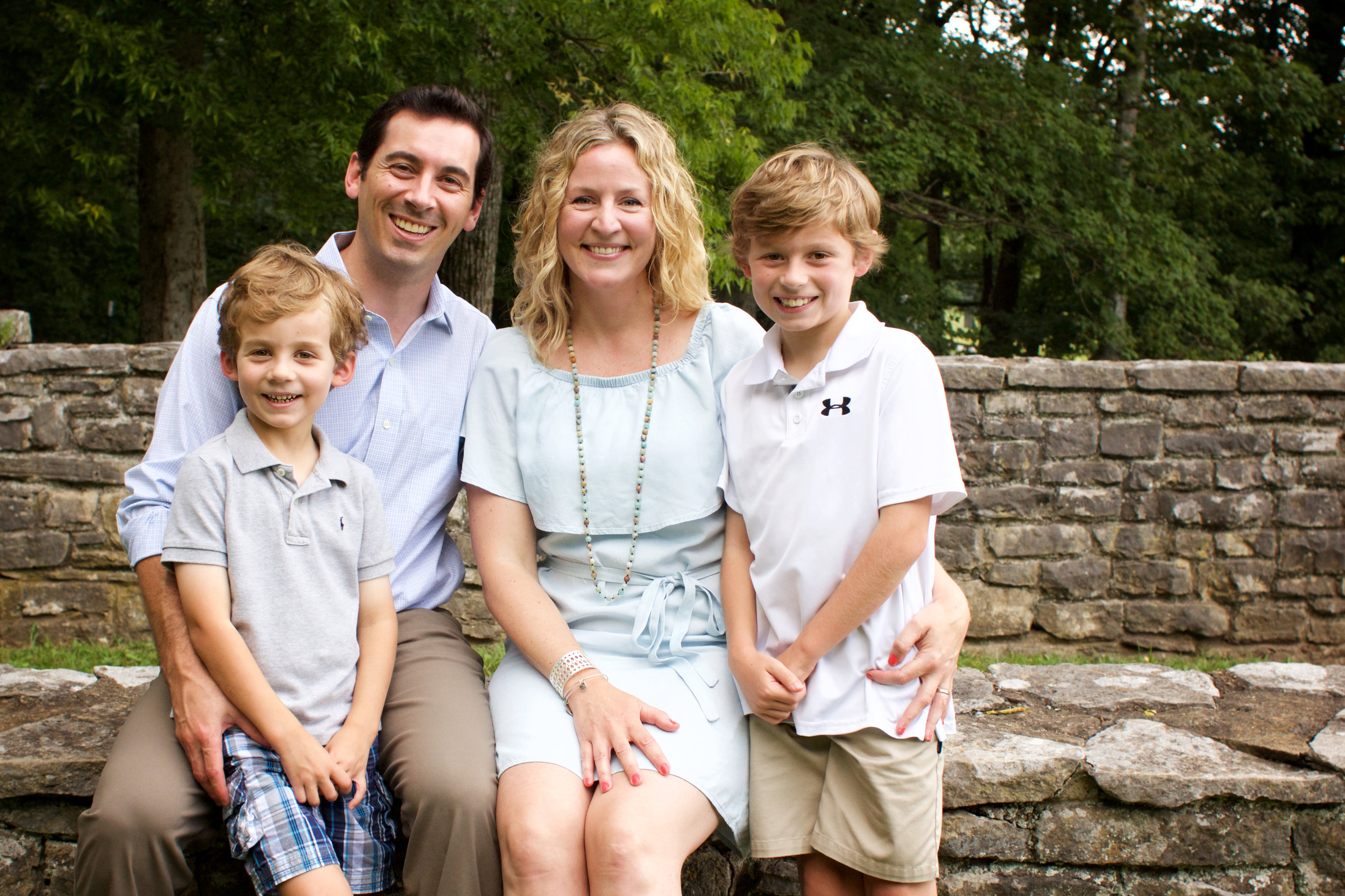 """Leslie and her sweet family - Chris, Hank, and Houston. """"Poop"""" was definitely mentioned to get those great smiles."""