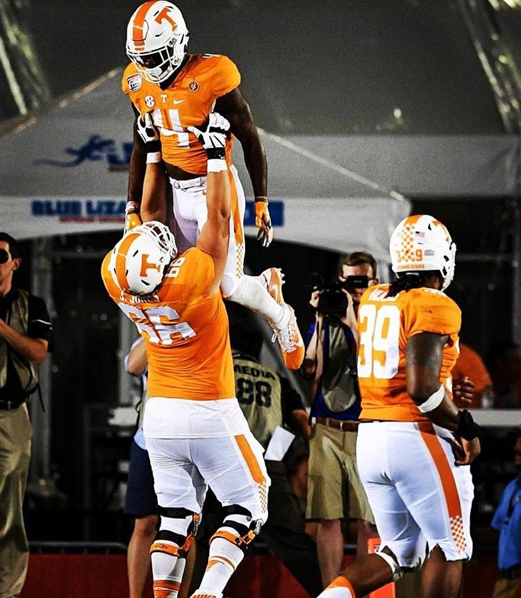 Jack as a UT Football player (the GIANT one lifting up his teammate)