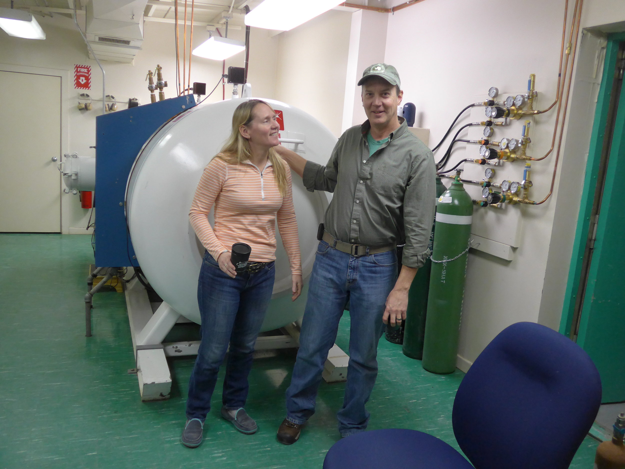 Megan and Michael Dore in front of the Mcmurdo General Hospital hyperbaric chamber  Ross Island, Antarctica