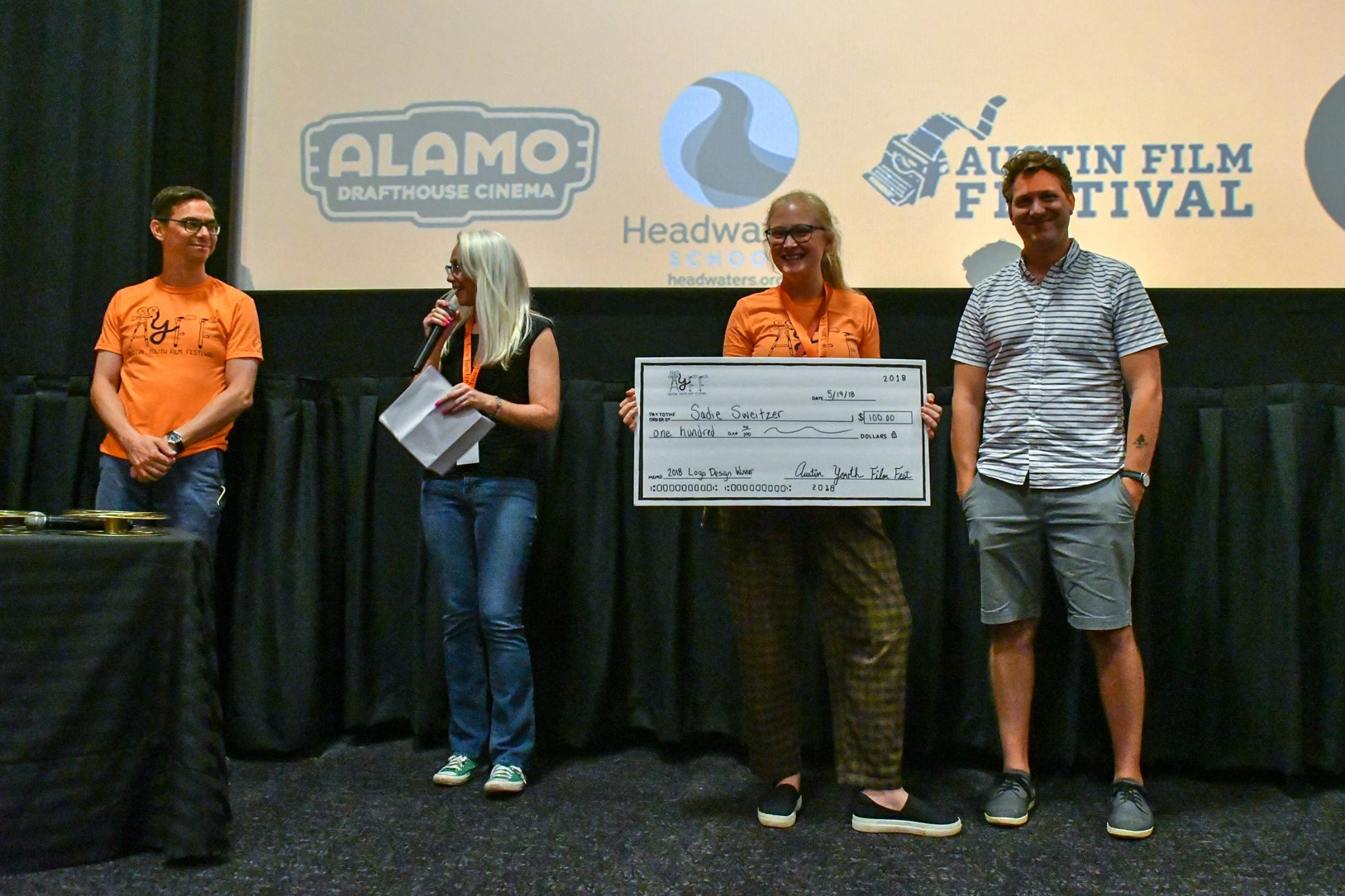 """Carrie presenting the """"big checks"""" at the Austin Youth Film Festival 2018 with Director Jeff Nichols"""