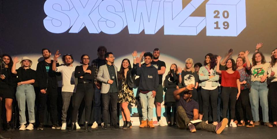 A blurry but beautiful photo of all our students waving on stage at our SXSW 2019 Official Film Showcase
