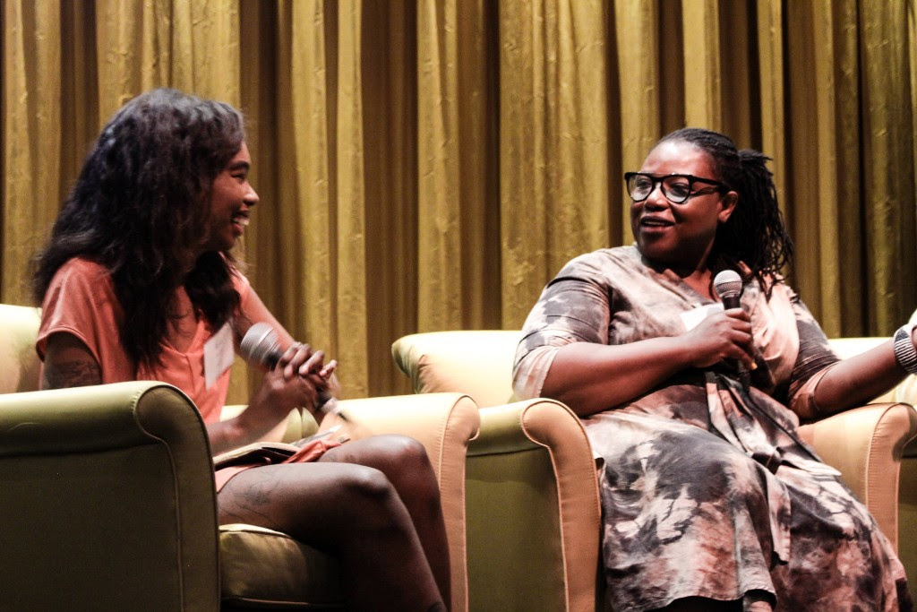 (from left) Moderator   Bria Royal  with panelist  Tracie Hall .