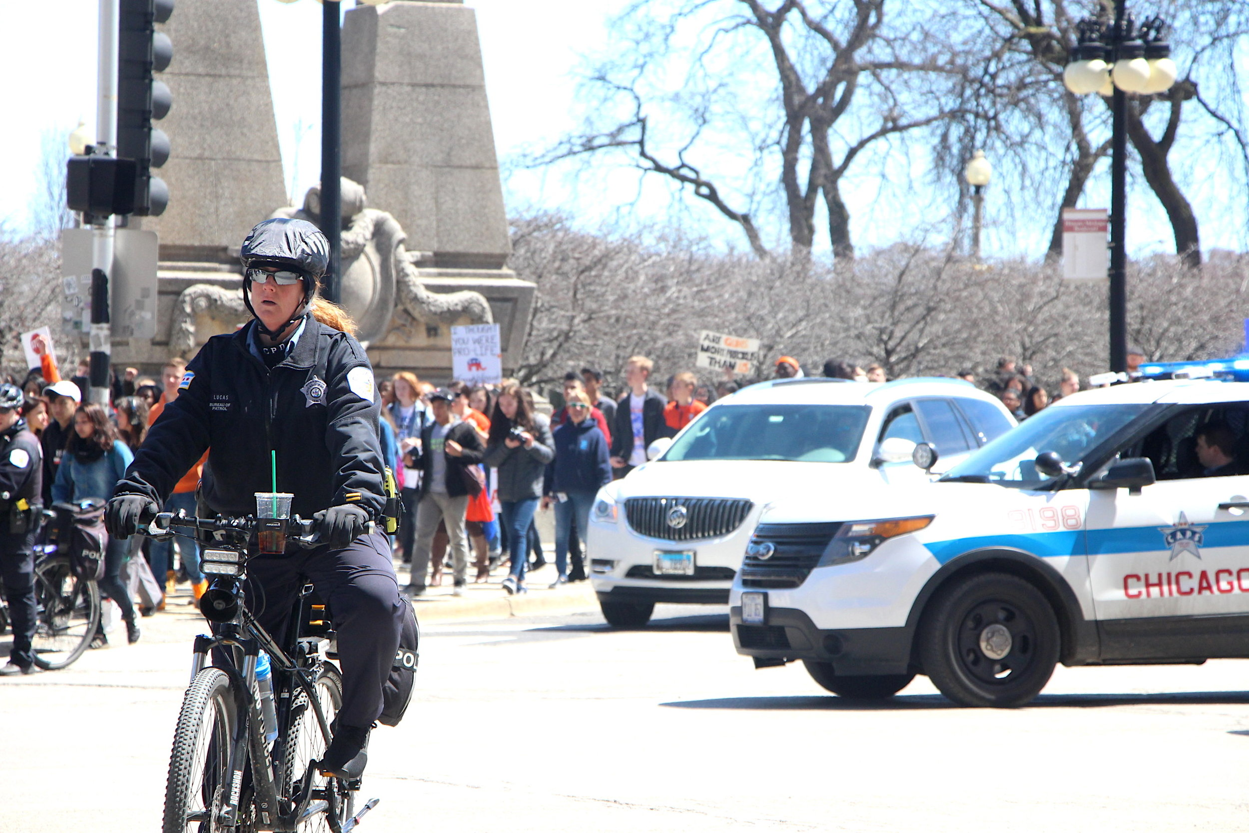 Students are escorted by a convoy of police as they make their way from Grant Park to the Federal Plaza.