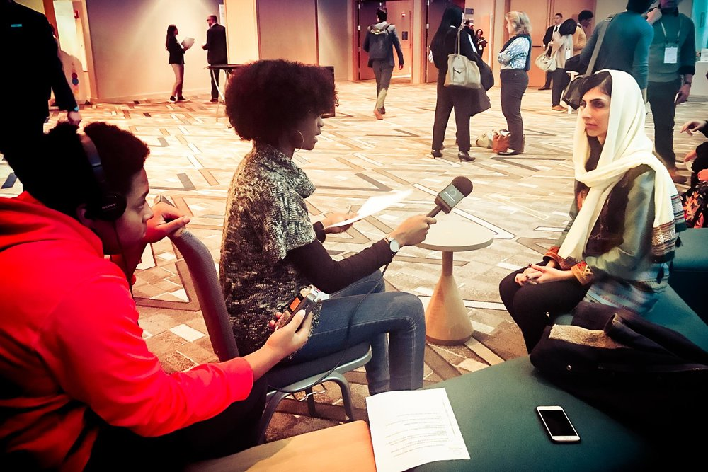 Patricia and Jamaari interviewing Roya Mahboob at The Obama Foundation summit