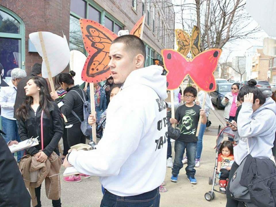 Berto Aguayo leads a demonstration in the Back of the Yards neighborhood  Credit: Juan Ayala