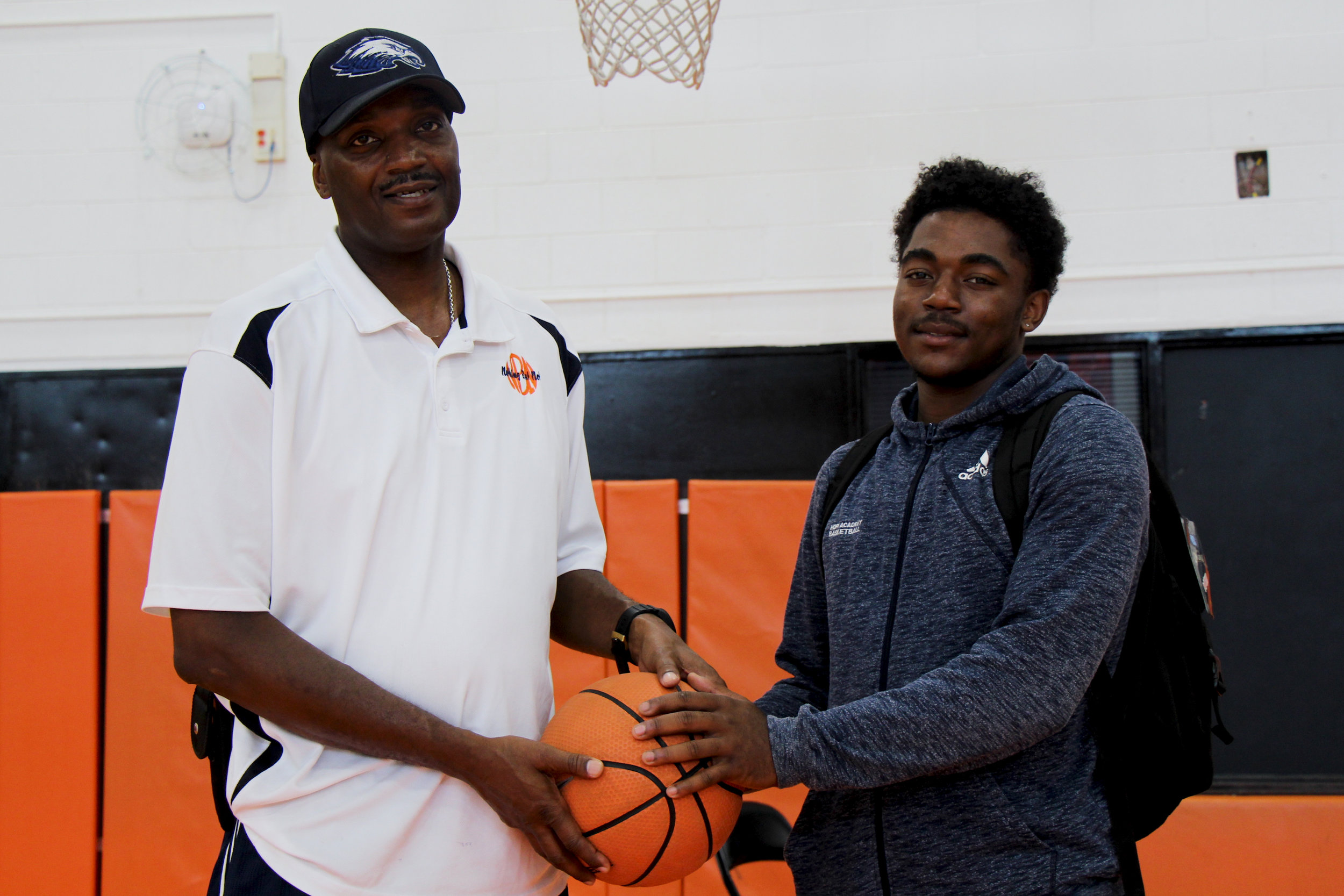 Hope Academy Head Coach Antwon Johnson(left)and Hope Academy Graduate Javion May(right)  Photo by: Isi Ativie