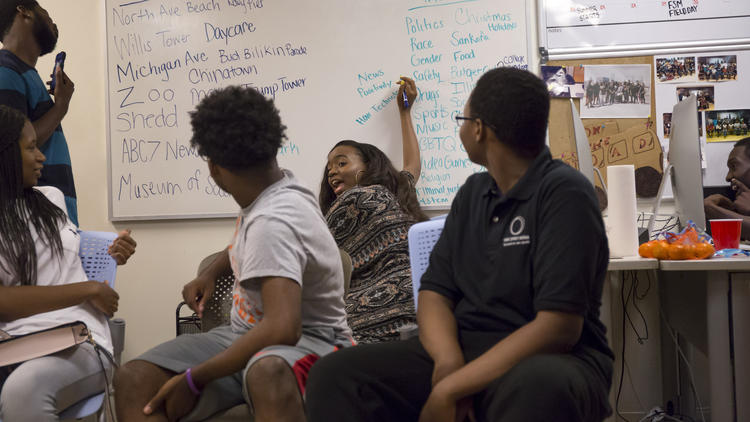 Jakira Smith, 18, writes down story ideas as students plan their summer newscasts. (Brian Cassella / Chicago Tribune)