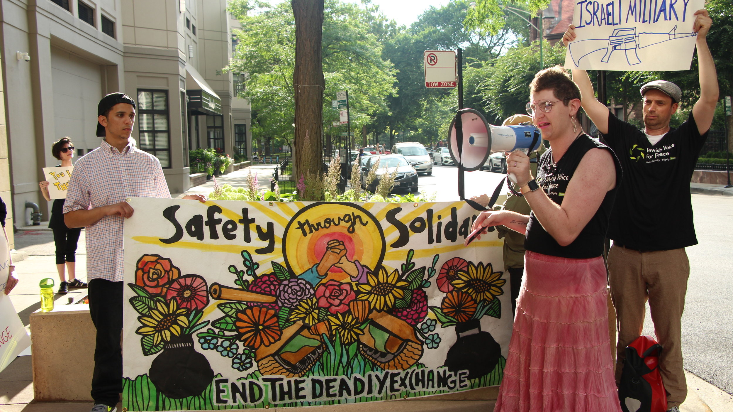"""Activist Stephanie Skora leads the crowd chanting, """"You Can't Rebrand Apartheid!""""    photo by: Pascal Sibino"""