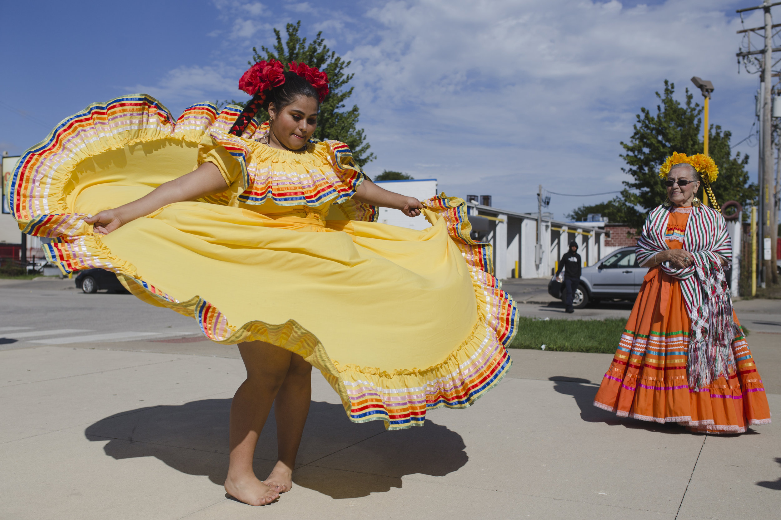 Monica Gonzales twirls for the camera after hours of dancing in high heels during the parade.