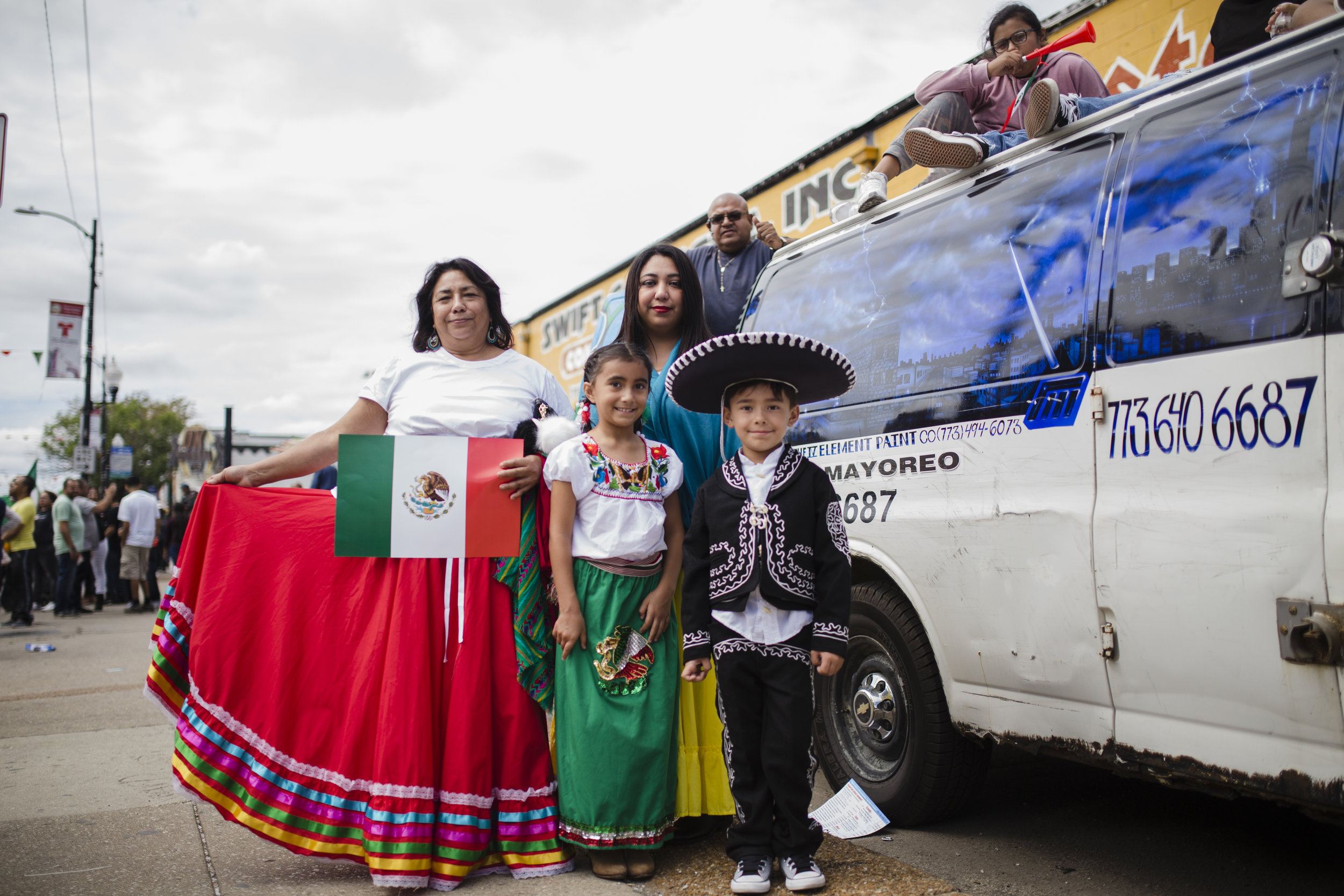 """Maria Mercadillo, Claudia Snyder and her kids James and Sophia. To Claudia, the parade's theme is """"very, very true to the culture"""" because they are family-oriented."""