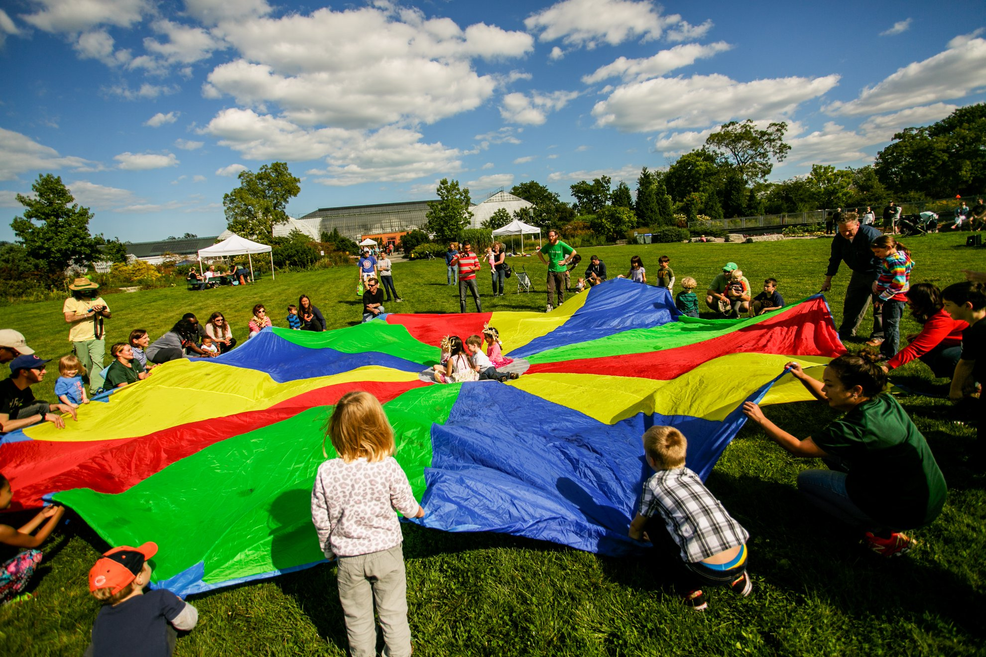 Children play with a parachute at the 2017 Harvest Day  Photo By: Courtesy of Garfield Park Conservatory