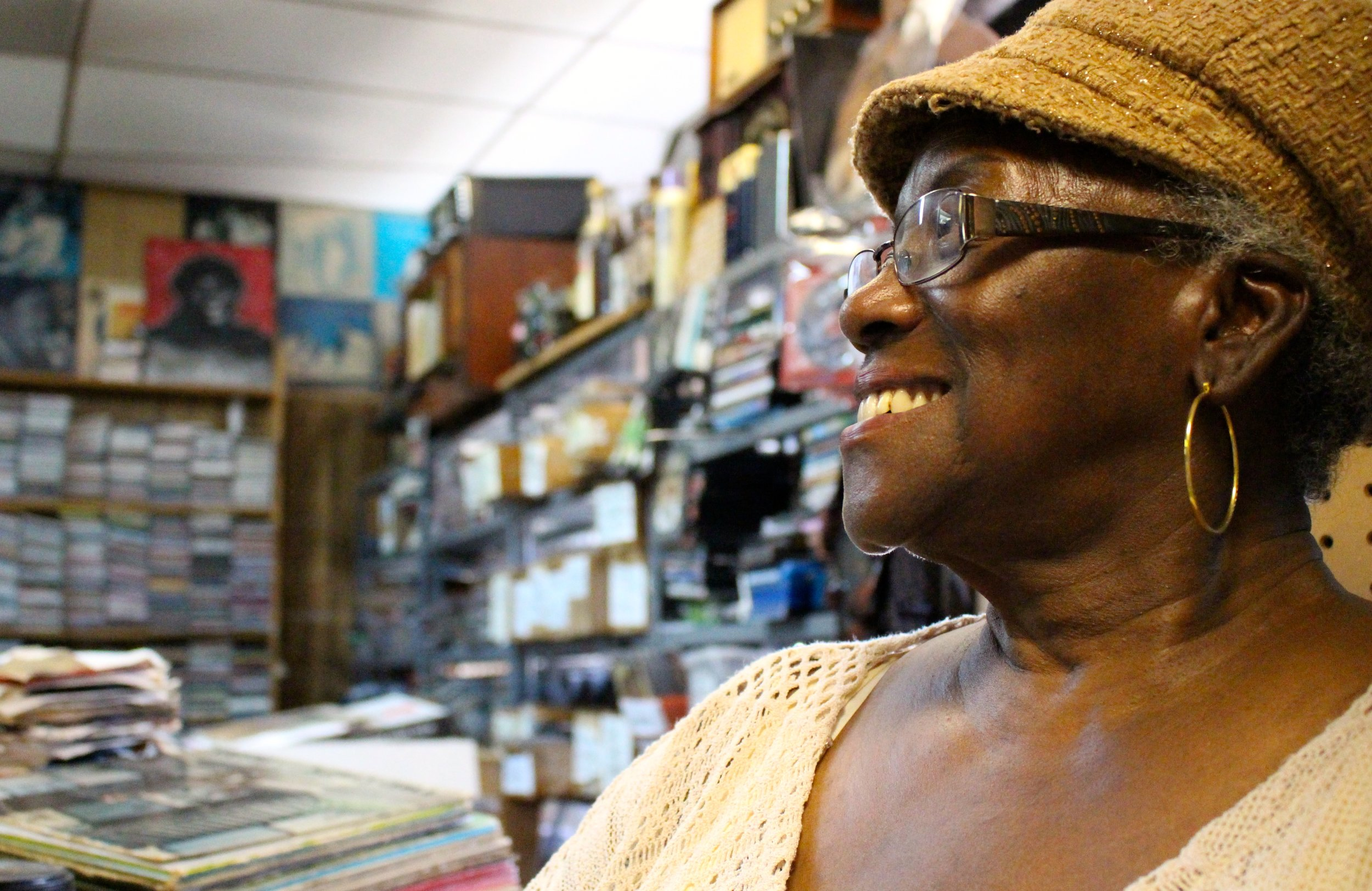 Marie Henderson, co-owner of Out of the Past Records in west side Chicago, laughs, as she thinks about her husband, Charlie Joe. The two have owned Out of the Past Records since 1986 and a thread of other businesses on West Madison Street over the years.  Photos by F. Amanda Tugade