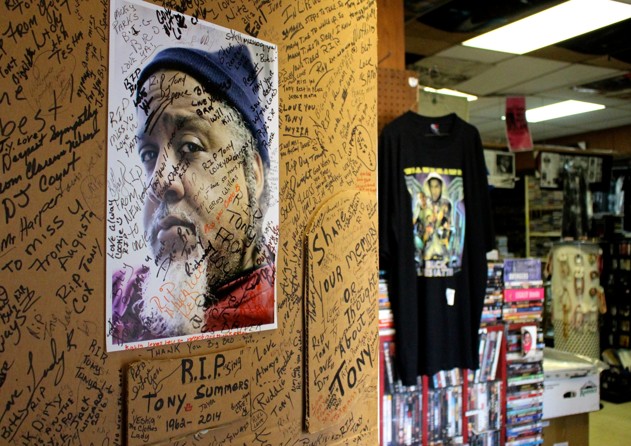 Just like Marie Henderson's cherished record collection, she extends her love for her family by putting up pictures of her customers, former employees, friends and neighbors. Featured is a shrine for Henderson's beloved friend, Tony Summers.
