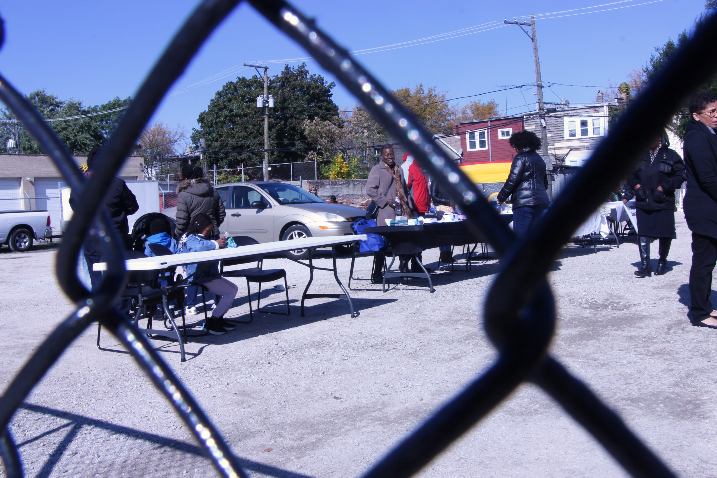 People beginning to pack up tables toward the end of the event,