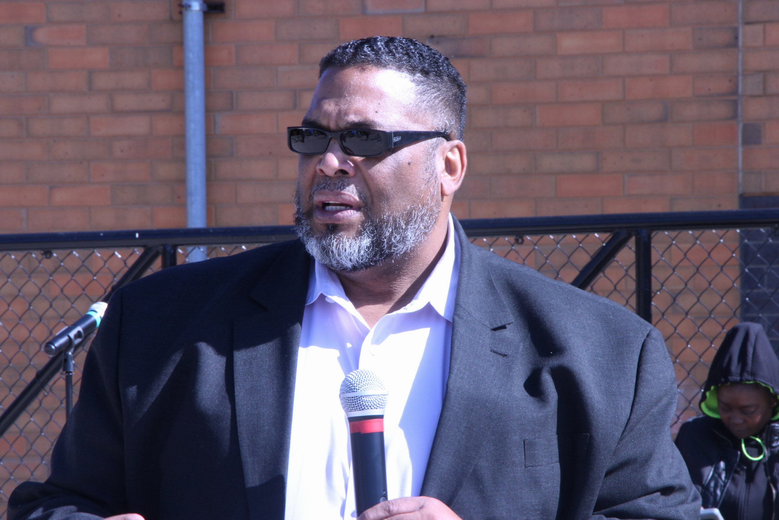 """Alderman Chris Taliaferro of the 29th Ward emphasized the importance of mental health and community participation. """"It is so important to educate ourselves about the criminal justice system,"""" he said."""